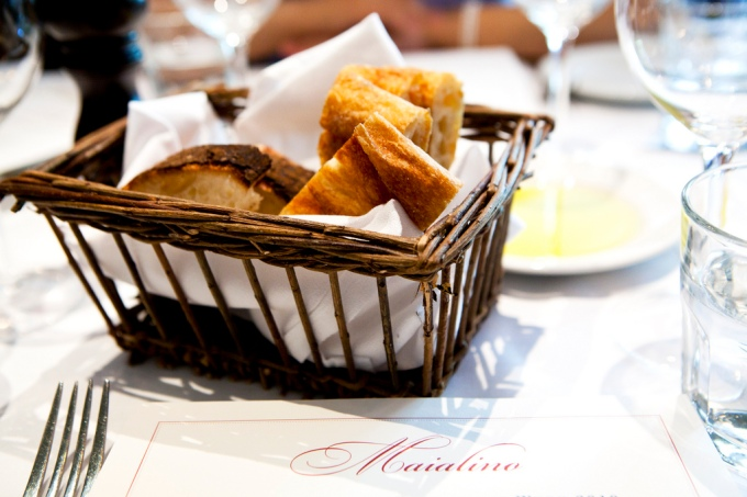 Bread basket, olive oil and menu