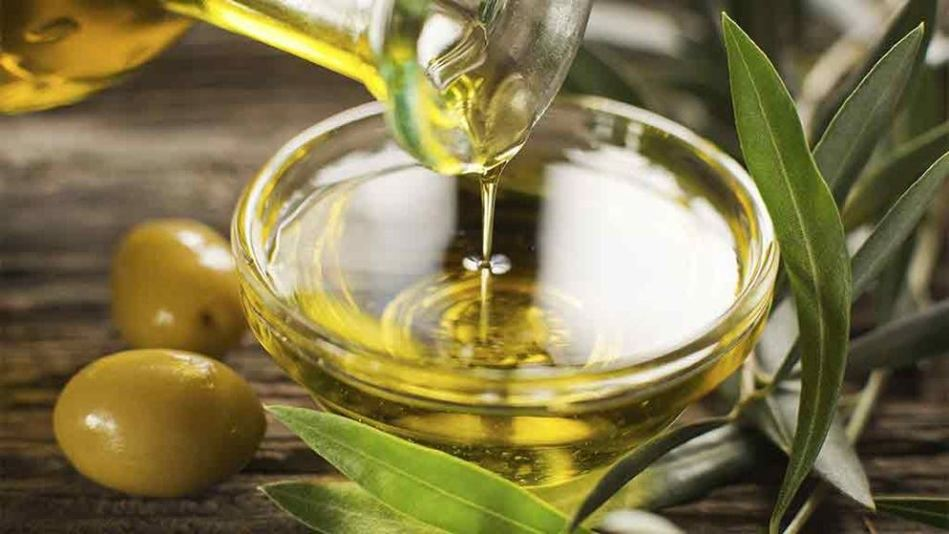 olive-oil-being-poured-into-a-bowl